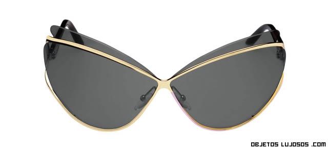 monturas doradas de gafas
