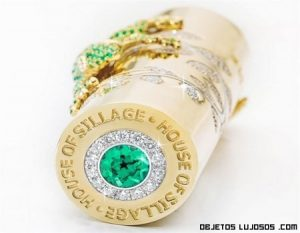 Perfume de viaje recubierto con oro